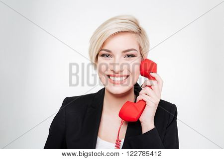 Cheerful businesswoman talking on the phone tube isolated on a white background