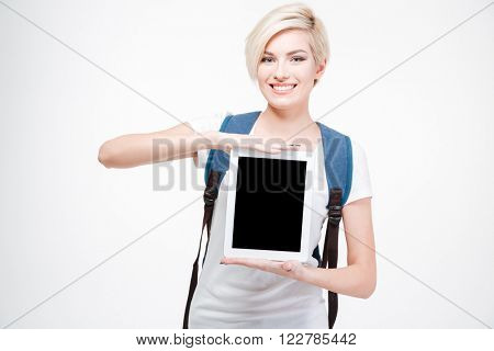 Smiling female student showing blank tablet computer screen isolated on a white background