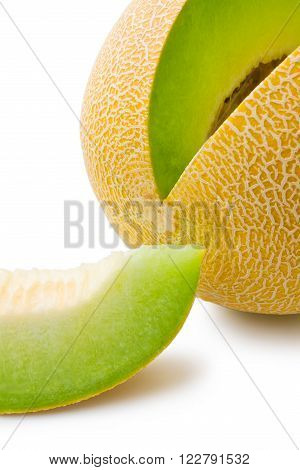 Ripe fresh melon honeydew and a slice close-up isolated on white background