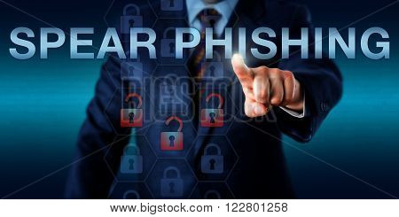White collar attacker is pressing SPEAR PHISHING on a touch screen. Information technology metaphor and computer security concept for a highly targeted phishing attack aimed at a specific victim.
