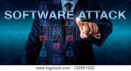 White collar hacker is touching SOFTWARE ATTACK on a virtual screen. Information technology metaphor and computer security concept for an application or program exploiting code vulnerabilities.