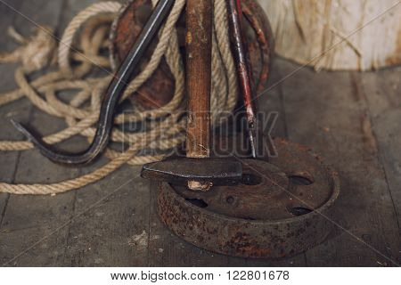 hammer and nail puller lays on wooden floor ** Note: Shallow depth of field