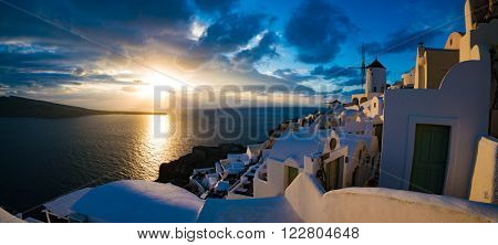 Beautiful sunset panorama  in Oia village, Santorini, Greece