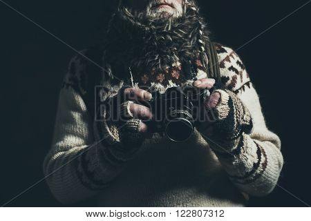 Weathered Hands Of Old Mountaineer Holding Slr Camera.