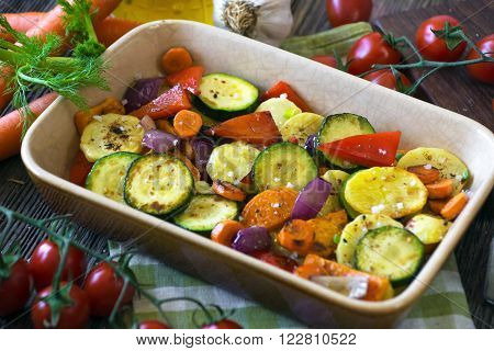 Roasted Vegetables With Olive Oil On Wooden Background