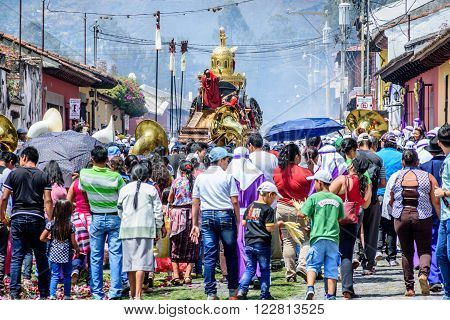 Antigua Guatemala - March 20 2016: The devout follow behind Palm Sunday procession in colonial town with most famous Holy Week celebrations in Latin America.