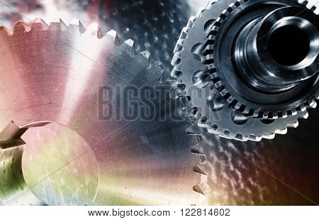 titanium aerospace-parts, cogwheels and bearings in shades of different colours
