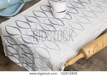 Towel With Blue Concave Lines Between Tray And Rolling Pin