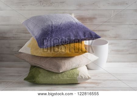Stack Of Four Throw Pillows Of Different Gradient Colors