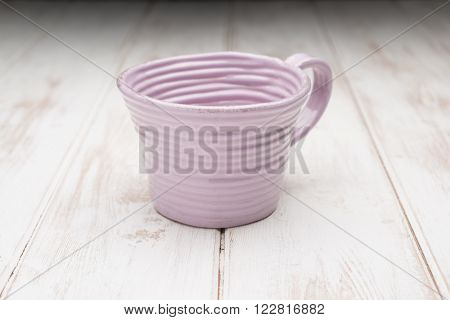 Pink Teacup On A White Wooden Panel Surface
