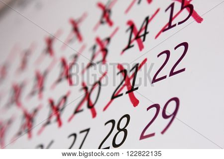 Calendar with days crossed out with a red cross.