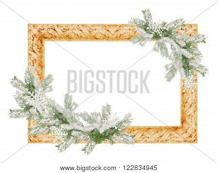 photo frame with snowy spruce tree branches isolated on a white background.