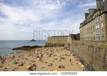 ST MALO, FRANCE - AUGUST 11: Crowded beach of St Malo in the summer, on August 11, 2012 in St Malo, Brittany, France.