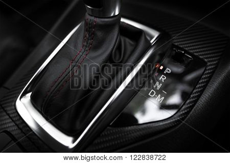 Car interior. The mechanism of switching modes of automatic transmission car.