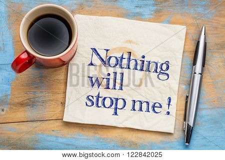 Nothing will stop me - handwriting on a napkin with a cup of coffee -determination concept