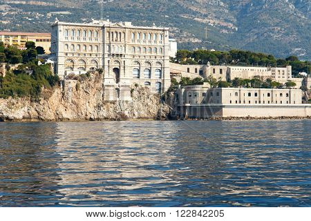 Color DSLR stock image of Monte Carlo harbor in Monaco with the Cousteau Oceanographic Museum, as seen from the blue Mediterranean Sea. Horizontal with copy space for text