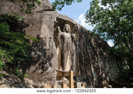 Raswehera, Sri Lanka JANUARY 17 2016: Sasseruwa Buddha (also known as the Reswehera Buddha) is a standing Buddha almost as high as the one in Aukana, though apparently uncompleted. The figure is in the abhaya mudra