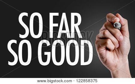 Hand writing the text: So Far So Good