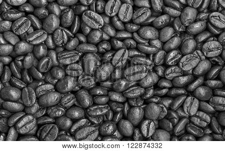 The background image is overcooked, black beans and coffee.