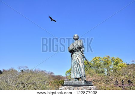 NAGASAKI, JAPAN - APRIL 6: The eagle and statue of Sakamoto Ryoma in Kazagashira Park on April 6, 2014 at Nagasaki, Japan. Sakamoto Ryoma is a prominent figure in Japan.