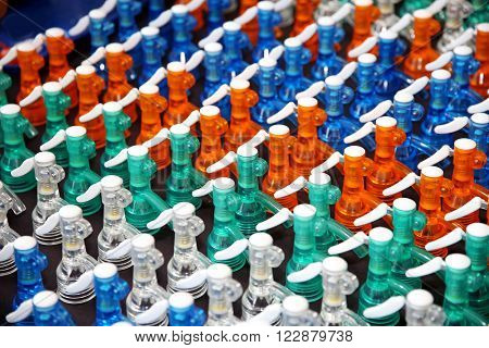 Colored removable plastic caps for soda water siphon bottles. Swallow depth of fields