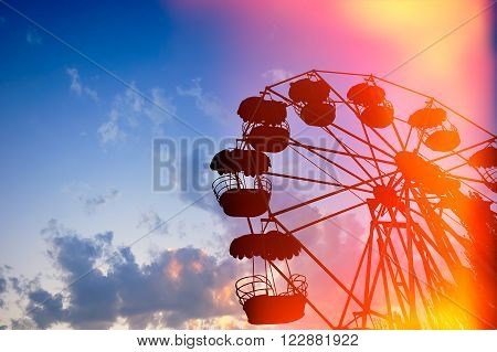 Ferris wheel on the background of night sky