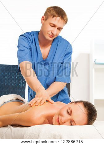 Picture of happy beautiful woman and  recreation therapist in massage salon