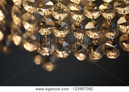 Retro Style Crystal Chandelier. Transparent Pendant Macro View. Light Background Soft Focus.