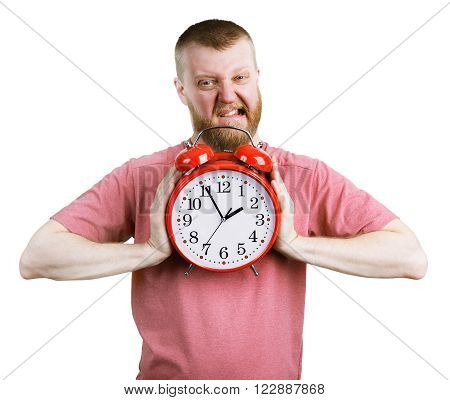 Angry man trying to break a big alarm clock