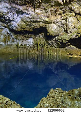 The completely underground cenote Tamchach-Ha near Coba in the Yucatan Peninsula of Mexico.