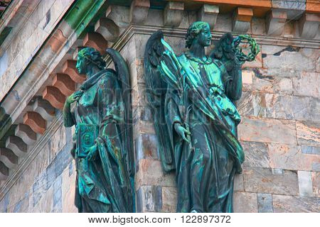 St. Petersburg, Russia - Feb 26, 2016: Two angels. Detail of Saint Isaac's Cathedral Fasade.