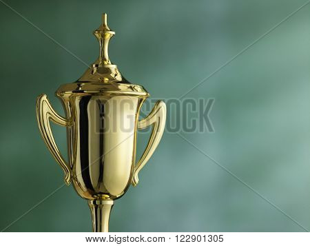 close up of the trophy in front of blackboard
