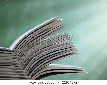 stack of the workbook in front of blackboard