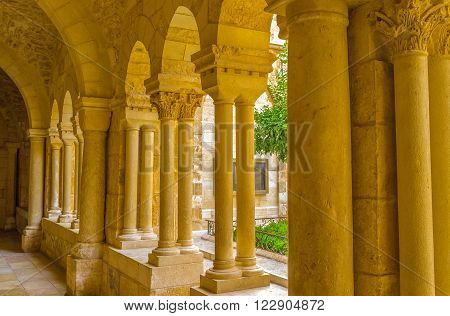 BETHLEHEM PALESTINE - FEBRUARY 18 2016: The covered corridor runs alongside the Franciscan courtyard of the Church of the Nativity on February 18 in Bethlehem.