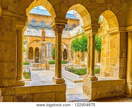 BETHLEHEM PALESTINE - FEBRUARY 18 2016: The view of the Franciscan courtyard with the St. Jerome statue in the middle on February 18 in Bethlehem.
