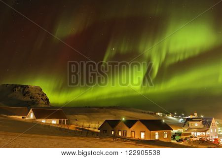 VIK ICELAND March 6 2016 : Strong Aurora Borealis in Iceland skies. Auroras are produced when the magnetosphere is disturbed by the solar win.
