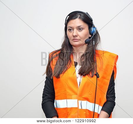 Woman Worker With Wired Headset and Safety West
