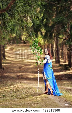 Young Woman In Spring Countryside Scenery