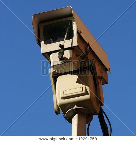 CCTV camera against blue sky