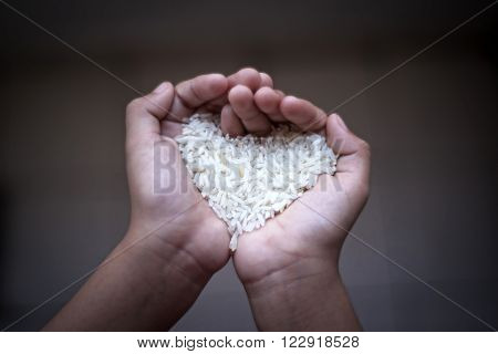 Hands holding rice.selective focus and shallow depth of field.