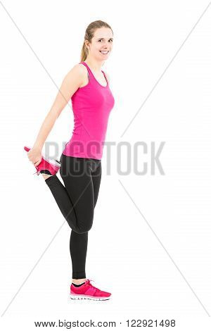 Sporty caucasian woman stretching her hips. Isolated on white background.