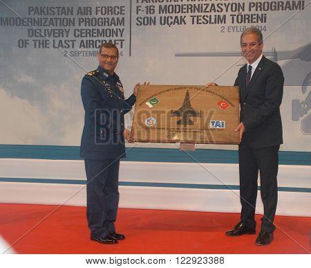 ANKARA/TURKEY-SEPTEMBER 2: Pakistan Air Force's Air Marshal Sohail Aman (L) and Muharrem Dortkasli (President & CEO of TAI) at the ceremony of