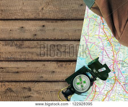 Magnetic compass is located on  map on background