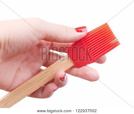 Red Silicone Brush cooking kitchen in her hand isolated on white background