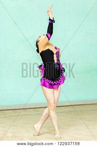 Cute Girl Doing Crafty Trick On Art Gymnastics Performance