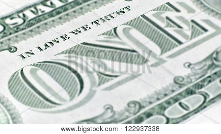 The United States one dollar bill, a macro closeup emphasizing the inscription which has been changed to