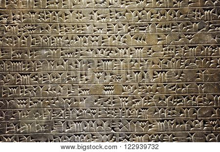 Ancient Assyrian cuneiform Sumerian writing on the wall
