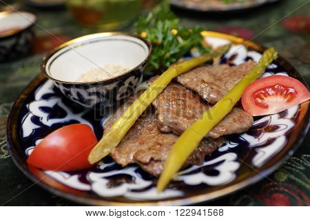 Plate With Veal Medallions And Asparagus