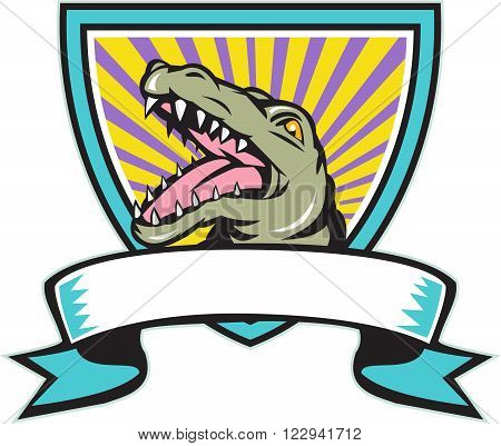 Illustration of an angry gator alligator crocodile head snout snapping set inside crest shield with ribbon scroll in front done in retro style on isolated background.