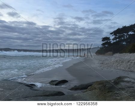 CARMEL - MARCH 2: A campfire burns at the beach on March 2, 2016 in Carmel-by-the-Sea, California, USA.